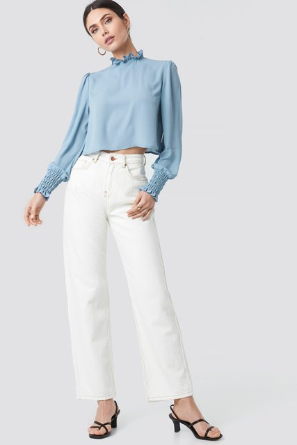 With white jeans and black low heeled shoes