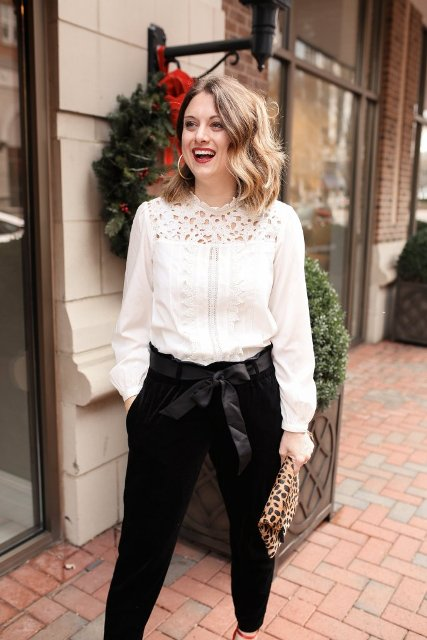 With white lace blouse, leopard printed clutch and red shoes