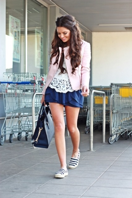With white lace blouse, navy blue ruffled skirt, striped flat shoes and tote bag
