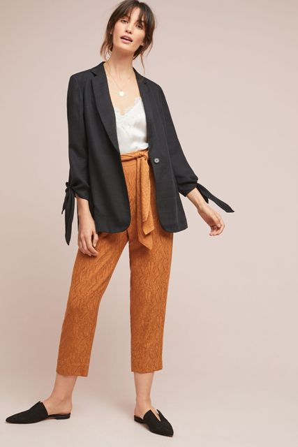 With white lace top, brown culottes and black flat mules
