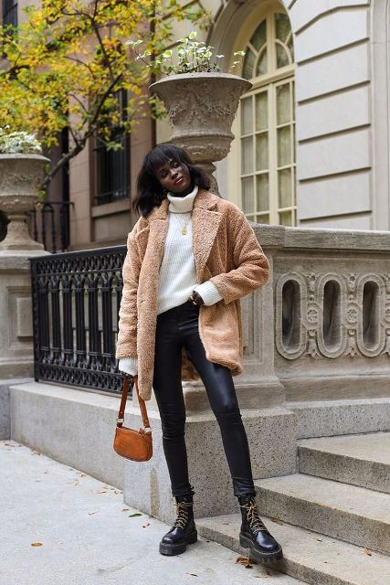 With white loose sweater, beige jacket, leather skinny pants and brown bag