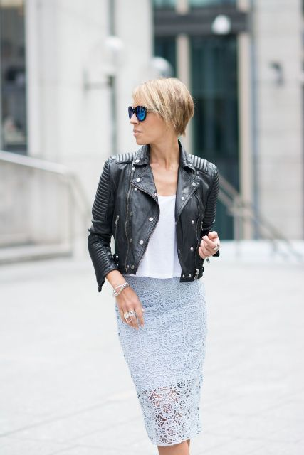 With white loose top and black leather jacket