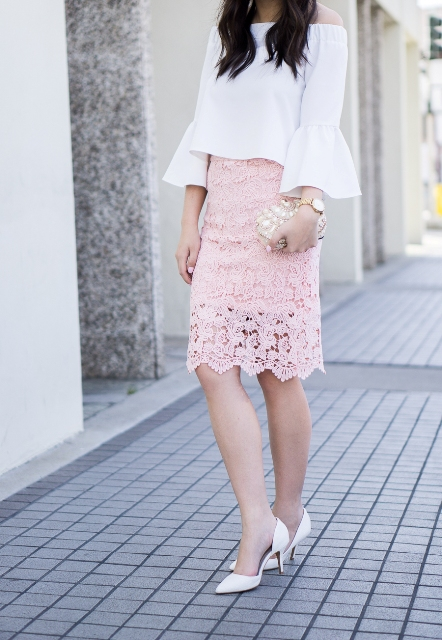 With white off the shoulder bell sleeved blouse, embellished clutch and white shoes