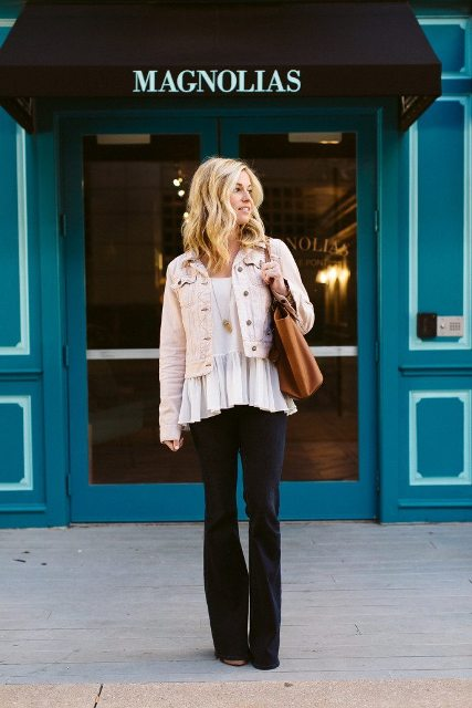 With white ruffle blouse, black flare pants and brown tote bag