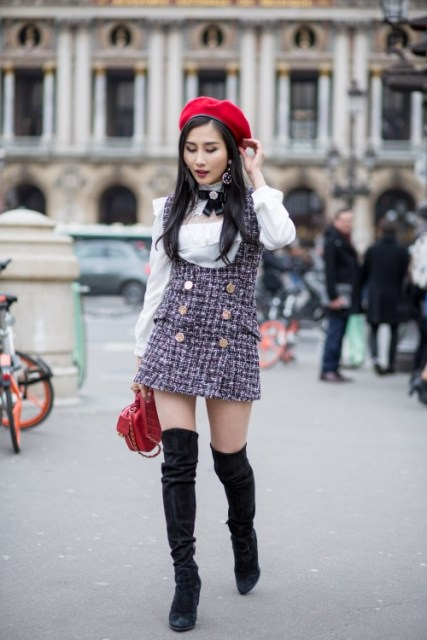 With white ruffled blouse, red beret, red leather bag and black suede over the knee boots