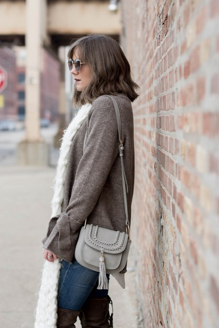 With white scarf, gray tassel bag, jeans and brown over the knee boots