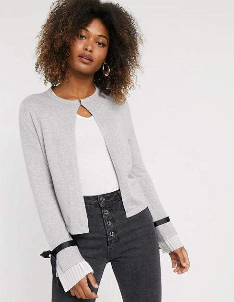 With white shirt and dark gray jeans