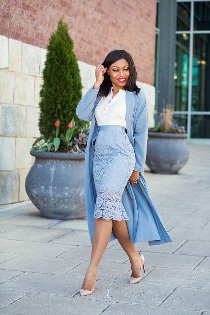 With white shirt, light blue midi coat and beige pumps