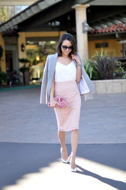 With white sleeveless top, gray blazer, pale pink clutch and silver pumps