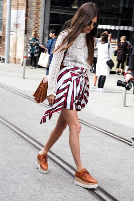 With white sweater, fringe bag and platform lace up shoes