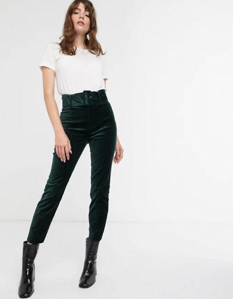 With white t-shirt and black patent leather mid calf boots