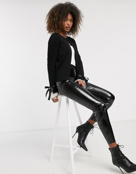 With white t shirt, black patent leather crop pants and black lace up boots