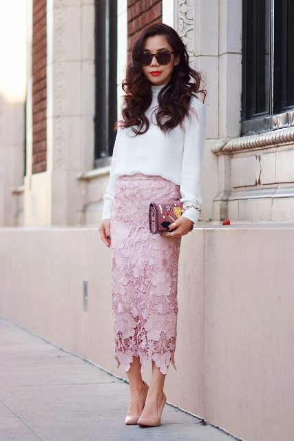 With white turtleneck, embellished clutch and beige pumps