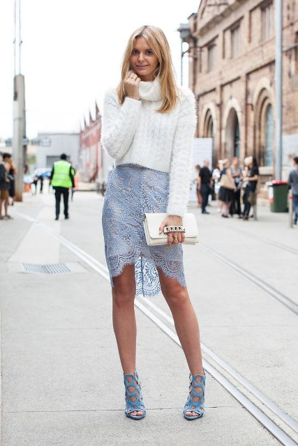 With white turtleneck sweater, white clutch and light blue shoes