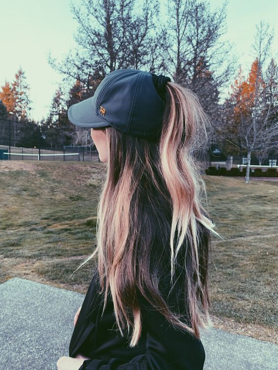 a baseball cap with waves down and a ponytail for maximal comfort in wearing