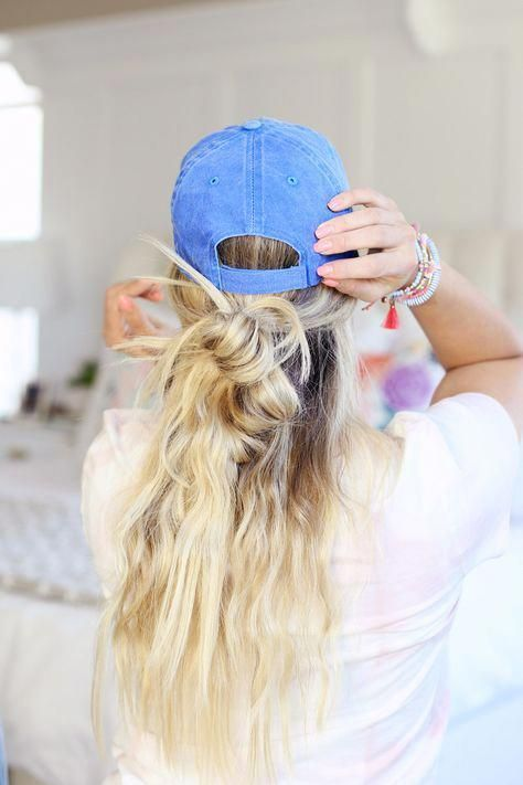 a baseball hat plus a messy twisted half updo and waves down for a relaxed look