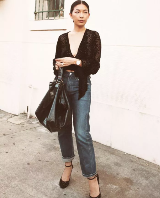 a black dressy crop blouse, navy relaxed jeans, polka dot midi heels and a comfy bag