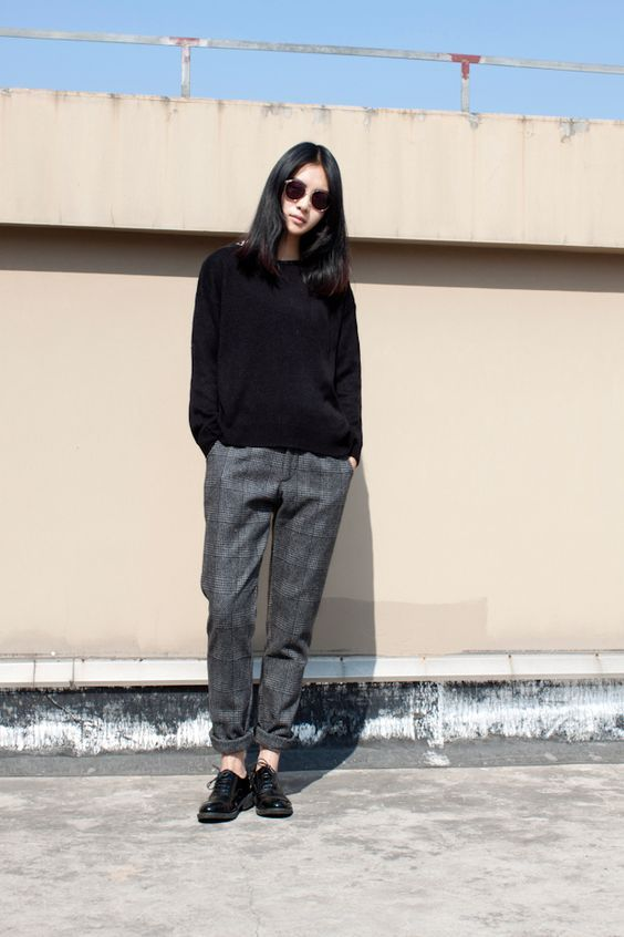 a black jumper, grey plaid pants, black Derby shoes for a stylish and casual look