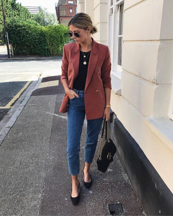a black tee, a burgundy blazer, black kitten heels and a bag plus layered necklaces