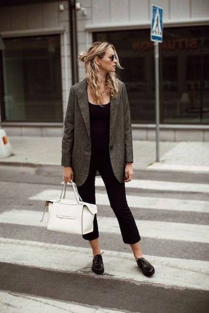 a black tee, black cropped pants, black Derby shoes, a grey oversized blazer, a white bag for work