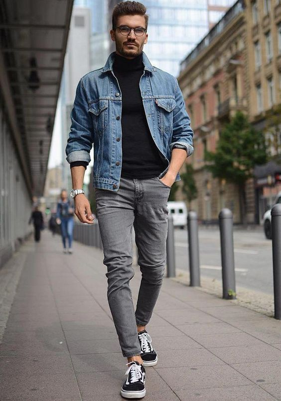 a black turtleneck, grey jeans, a blue denim jacket and black sneakers for a casual look