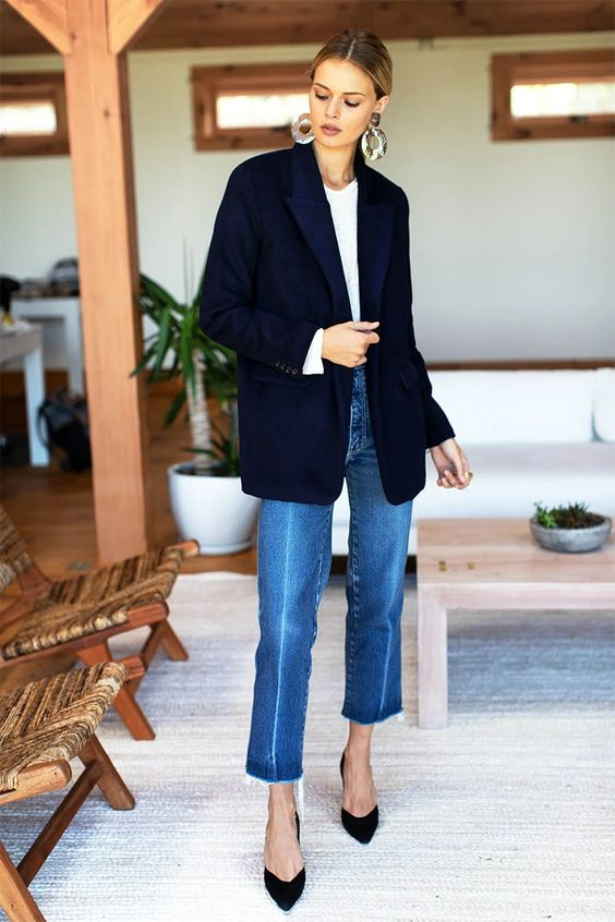 a classic look with a modern feel - a white t-shirt, blue jeans, a navy blazer, black shoes and statement earrings
