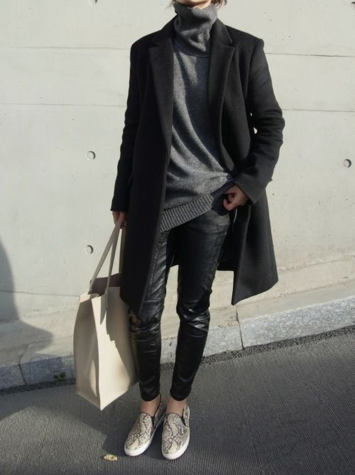 a modern everyday look with an oversized grey turtleneck, black leather pants, snakeskin slipons, a short coat and a creamy tote