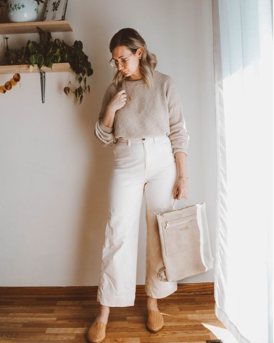 a neutral look with a grey jumper, white straight jeans, tan flats, a neutral tote and glasses