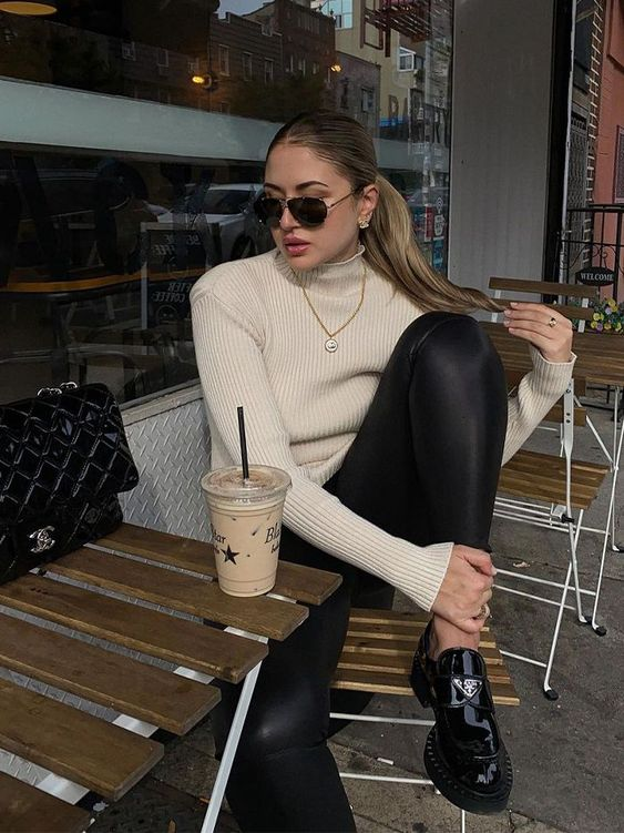 a neutral turtleneck, black leggings, black lacquer chunky loafers for an everyday look