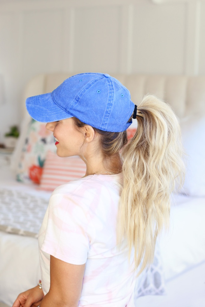 a perky ponytail paired with a blue denim cap are a lovely and simple idea to do last minute