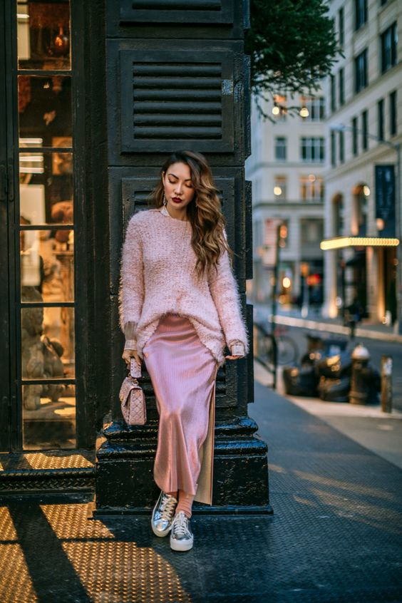 a pink spring look with a jumper, a slip skirt, silver sneakers and a pink bag plus statement earrings for a cold day