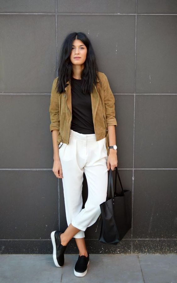 a tan suede jacket, a black tee, white cropped pants, platform slipons and a black tote for every day