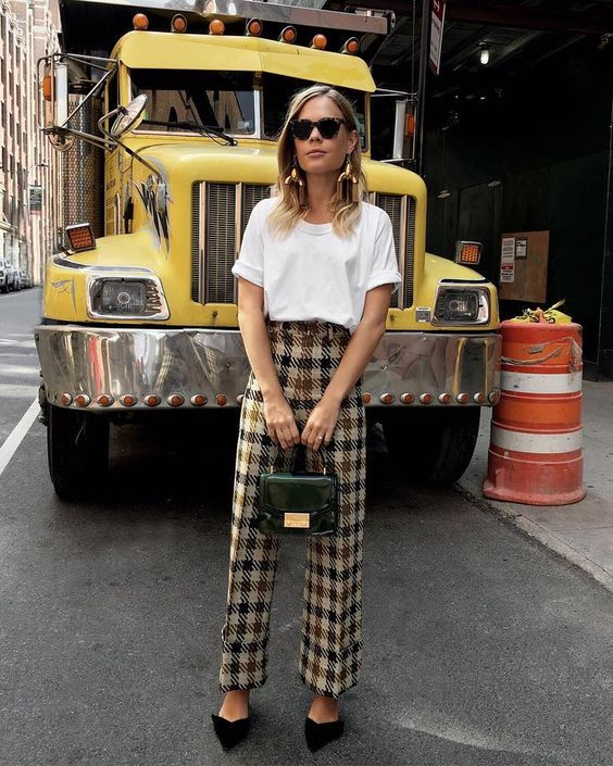 a white oversized t-shirt, plaid trousers, black flat shoes and a dark green mini bag