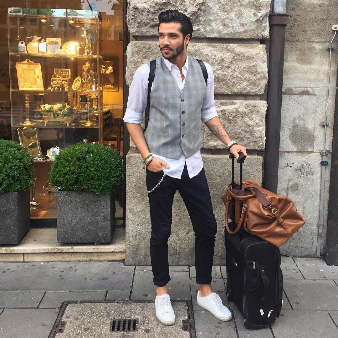 a white shirt, a grey plaid vest, black jeans, white sneakers for a more elegant still casual look
