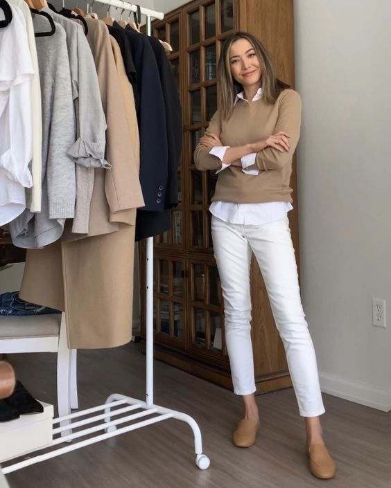 a white shirt, a tan jumper, white straight jeans, tan mules for a monochromatic spring work look