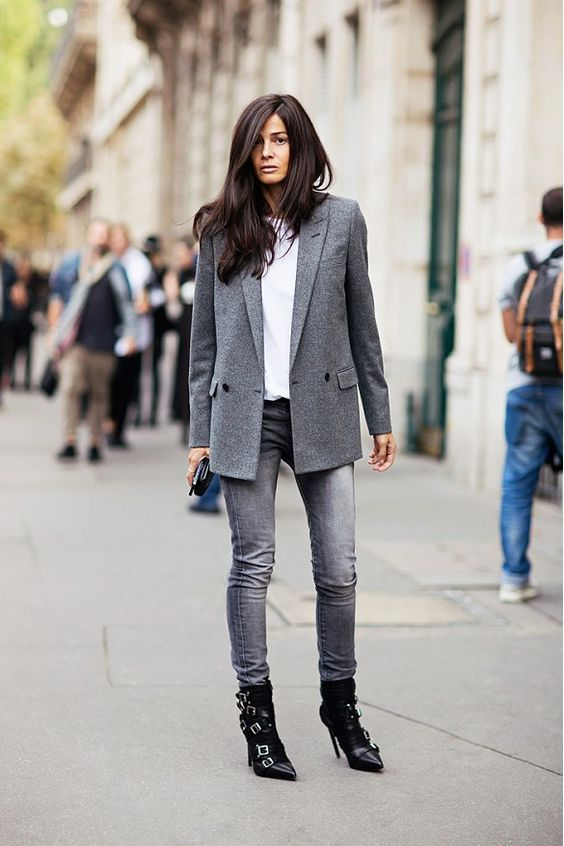 a white t-shirt, a grey blazer, grey skinnies, black belted boots and a black clutch for a simple spring look