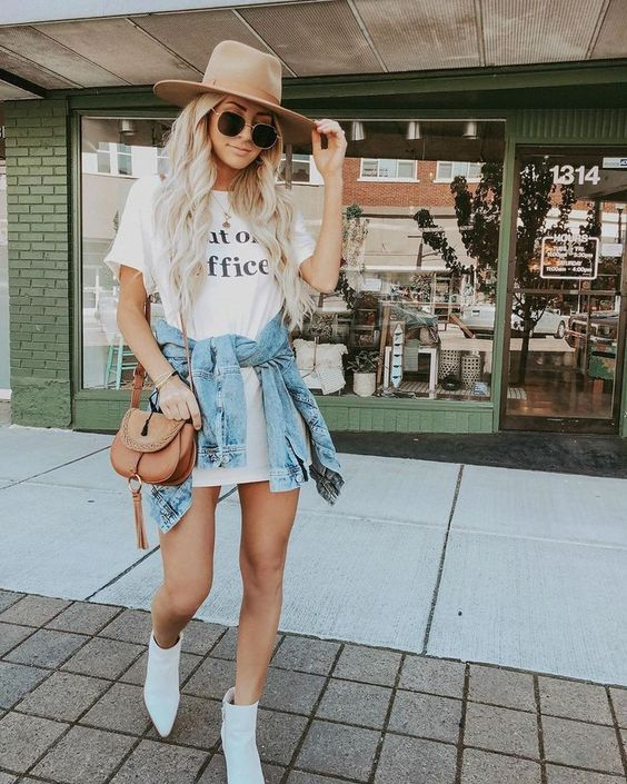 a white t-shirt dress, a blue denim jacket, white booties, a hat and a bag for a simple date look
