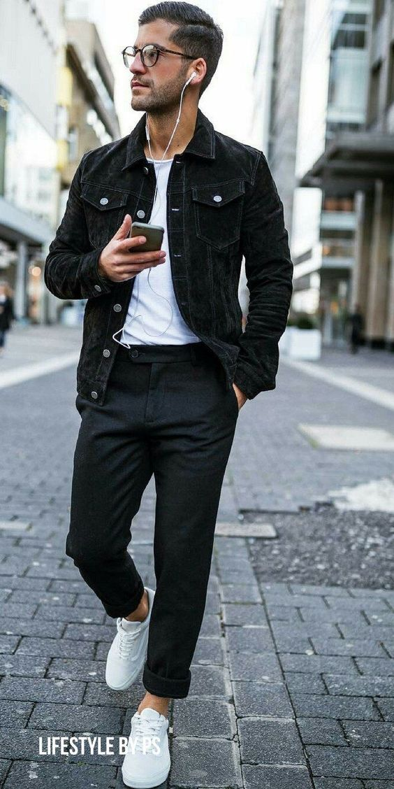 a white tee, a black denim jacket, black pants, white sneakers for a monochromatic look