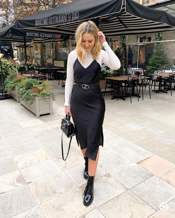 a white turtleneck, a black slip midi dress, a belt, black boots and a black bag for a date