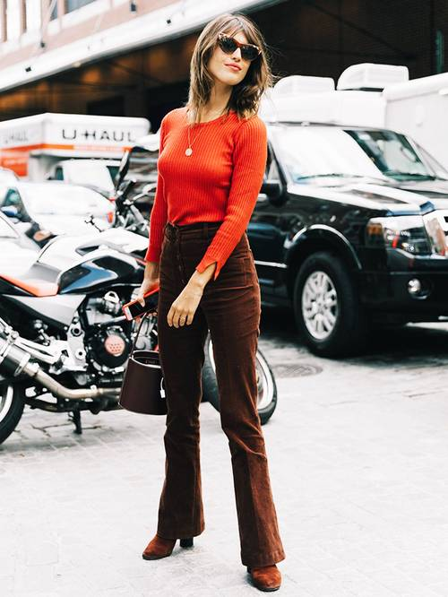 an orange jumper, high waisted corduroy pants, rust colored boots and a bucket bag for a 70s look