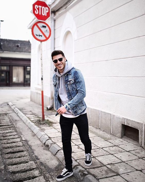 black jeans, a grey hoodie, a blue denim jacket and black sneakers for a casual date look