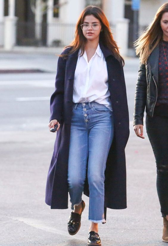 blue jeans, a white shirt, a navy coat and black chunky loafers for a casual and everyday look