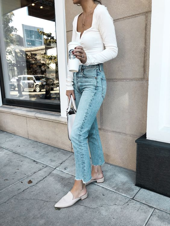 light blue jeans, white mules, a white square cut top and a white bag for spring