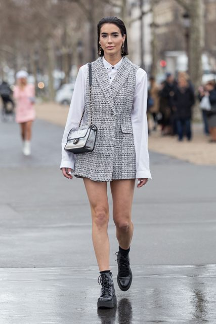 With white button down shirt, transparent bag and black lace up platform boots