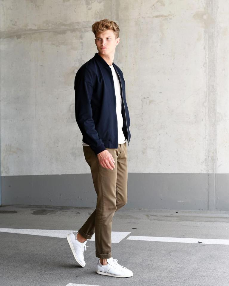 tan chinos, a white tee, a navy bomber jacket, white sneakers for a simple casual date