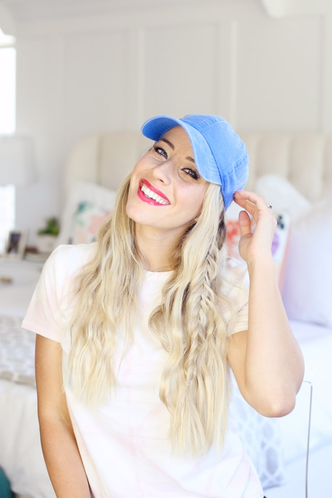 wavy textured hair down plus a regular braid and a cap for a more relaxed and rustic look