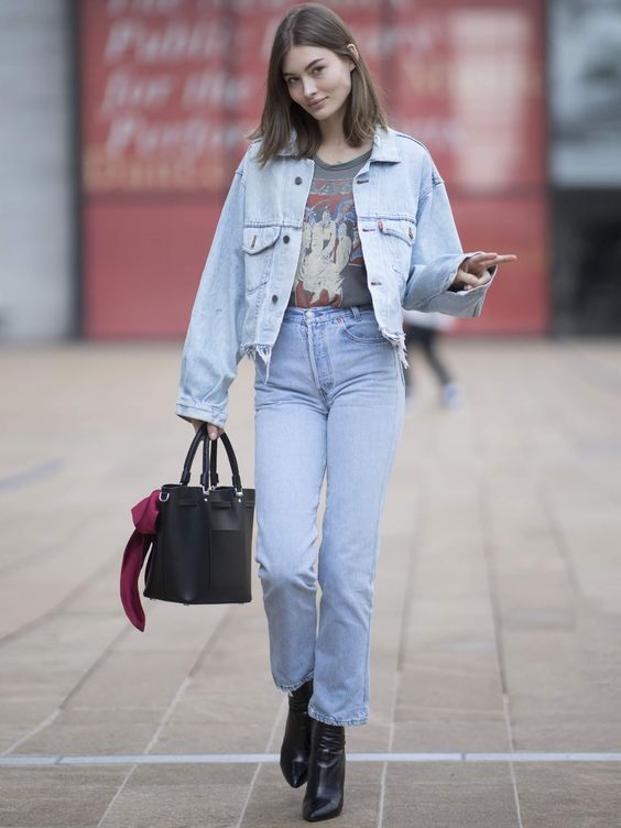 a grey printed t-shirt, blue straight jeans, a blue denim jacket, black boots, a black bag for spring