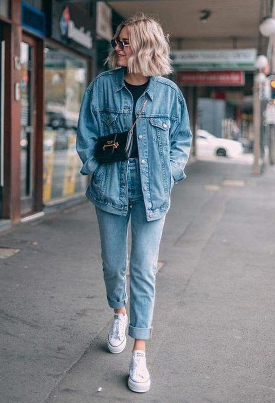 a simple and chic double denim look with matching jeans and a jacket, a black t-shirt, white sneakers, a black bag