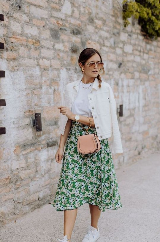 10 a white t-shirt, a white denim jacket, a green floral wrap skirt, white sneakers and a blush bag
