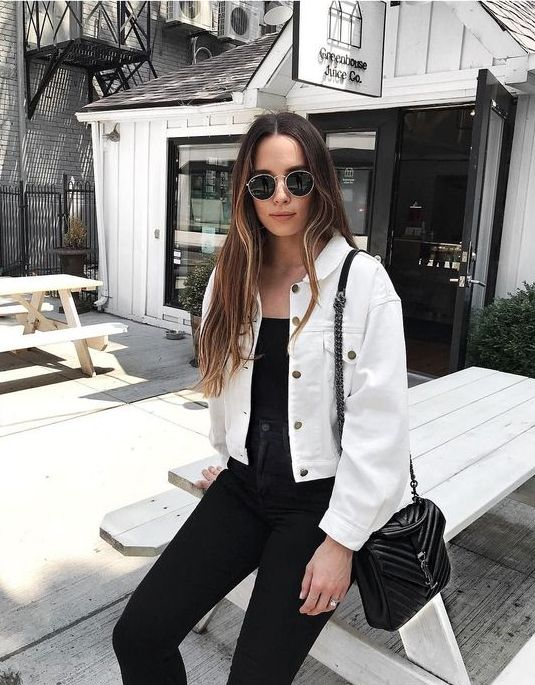13 a black top, skinnies, a black bag and a white denim cropped jacket for a contrasting look